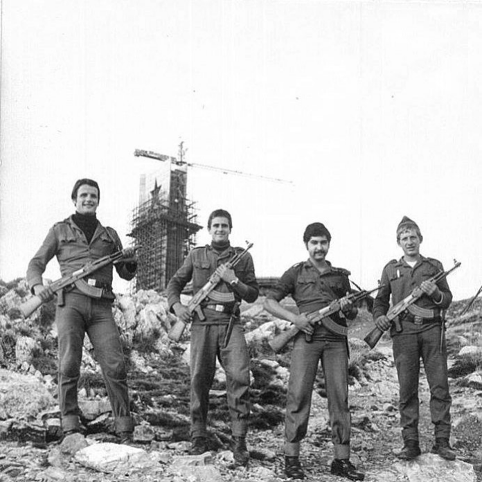 Military construction workers posing during the construction of Buzludzha's tower, 1977.