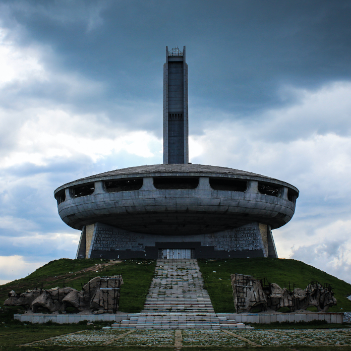 The Buzludzha Memorial House, as seen from the front, during gloomy weather.
