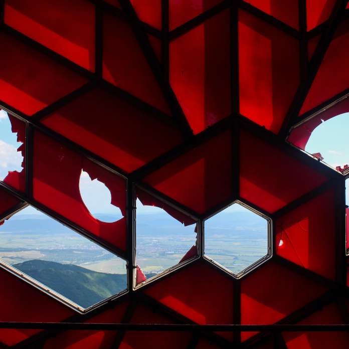 Looking through Buzludzha ruby red socialist star.